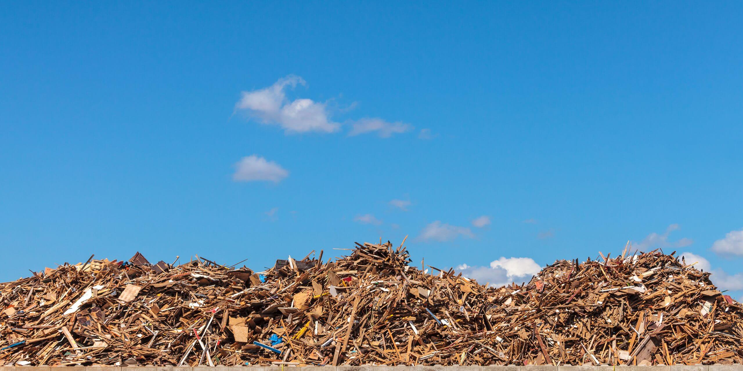 Panoramic image of a large pile of wood on a garbage depot